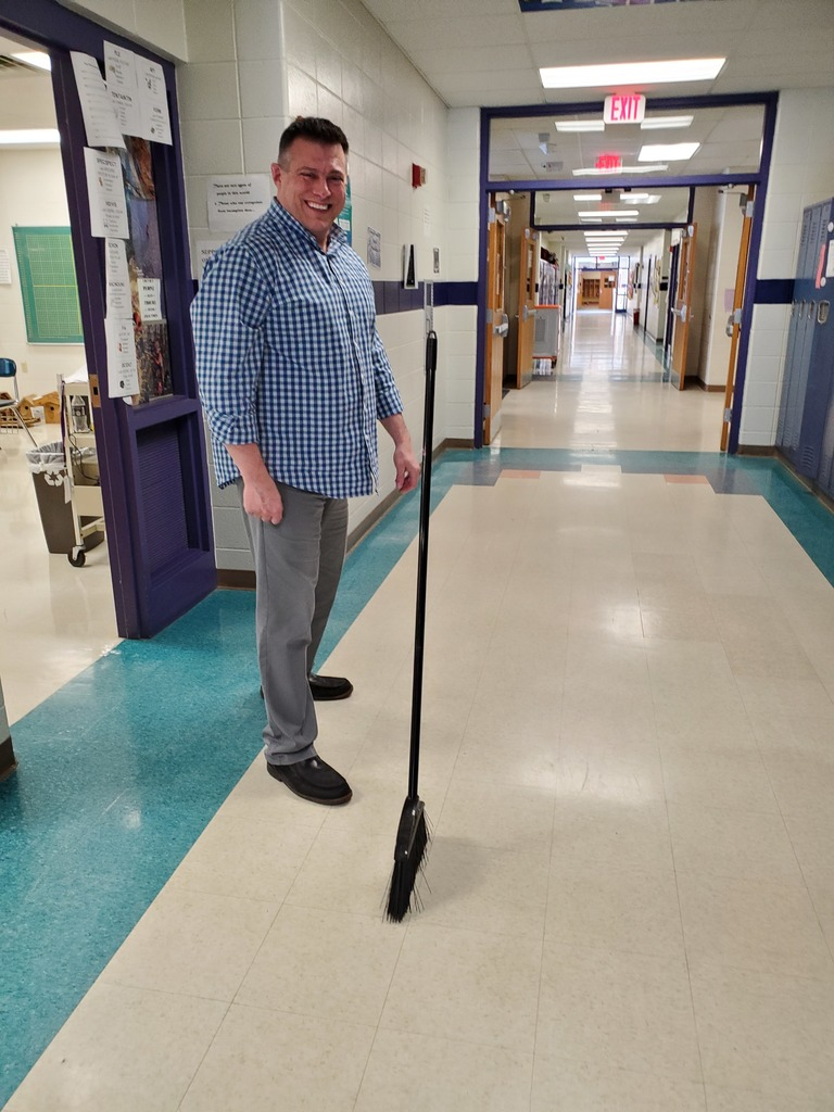 Mr. Triphan with a standing broom