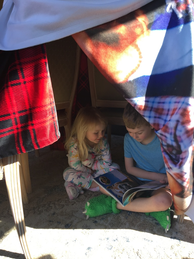 Curtis and his sister read in their fort