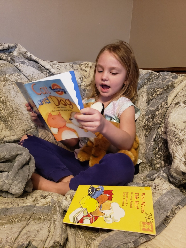Gracelynn's tiger likes to listen to her read