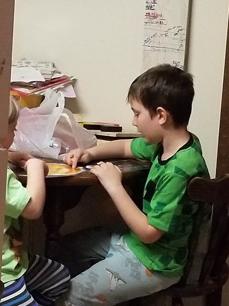 Parker reads to his sister