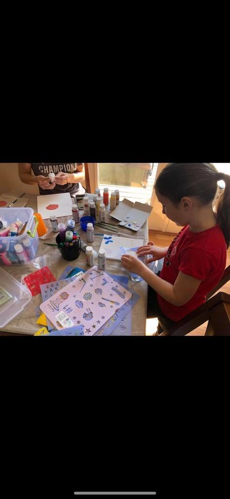 Elise works with her sister on art projects